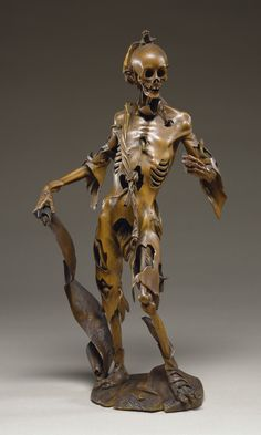 """1520s: Memento Mori. """"Skeleton clothed in tattered flesh holds a scroll bearing the Latin inscription, """"I am what you will be. I was what you are. For every man is this so."""" The artist -probably Hans Leinberger – has depicted the cadaver in a graceful pose that mimics that of Adam in Albrecht Dürer's famous engraving of Adam and Eve"""""""