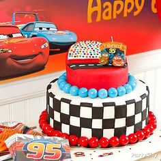Treat your pit crew to a rad Cars cake. Gumballs + fondant checkered flags + a Lightning & Mater candle = yummy AND fun!