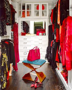 The master closet was fitted out by California Closets; the clothing is by Roberto Cavalli, and the stool is by Carol Egan.