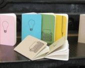 """from albertinepress on etsy , eighteen dollars for a set of 3 """"Bright Ideas"""" notepads(one has a light bulb, one a pencil and one a typewritter on the front), 40 blank pages in each,  in various colors.  Think TEACHERS !"""