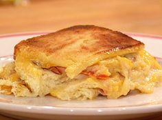 Emeril Lagasse's Turkey Club Casserole  I saw Emeril make this on Rachael Ray earlier this week. I think I would like to make it but change it up a little bit. Use   Swiss cheese in stead of cheddar and also add mushrooms and spinach.