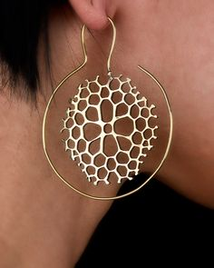 I adore this Etsy shop. Chunky solid metal nature-inspired jewelry. Some of the best stuff is for stretched ears, though. Brass Hoop Tribal Earrings Coral Pattern. $54.00, via Etsy.