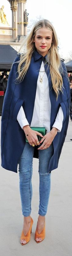 Blue satin cape, orange heels and emerald clutch.