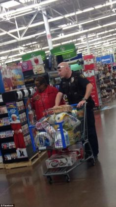 Act of Kindness: Officer John Holder of the DeSoto, Police Department was 73-year-old Dorothy Shepard braved the Thanksgiving shopping crowds at a Walmart store in DeSoto