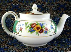 This is a vintage teapot made by Allertons, England during the 1930s in the Georgian pattern and green colorway. The bone china teapotis 5.25 inches high to th