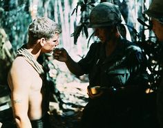 U1588921  23 Nov 1967, Hill 875, South Vietnam --- An Army chaplain administers Holy Communion to member of 173rd airborne brigade prior to final assault on Hill 875, located 15 miles southwest of Dak To. --- Image by © Bettmann/CORBIS