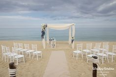 Beach ceremony in blue and white