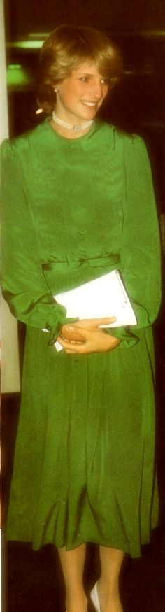 April 30, 1983: Princess Diana's and Prince Charles' Departure from Auckland, NZ for Eleuthera. Diana in a single narrow-belted dress in emerald-green chiffon. Plain neckline and long sleeves ruffled at the cuff. Wearing her 3-stringed pearl choker that was an 18th Birthday gift from her father.