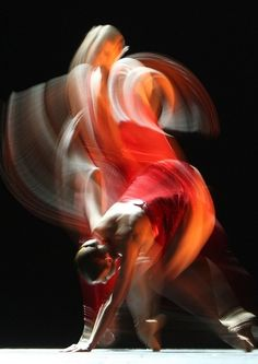 The #picture shoe MOVEMENT because the picture is kind of blurred and the girl is dancing. The way the dress if flowing in the air moves eyes through out the piece.