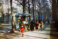 A girl rides a Scooter down Avenue Hoche in 1914. | 20 Mind-Blowing Color Pics Of Early 1900s Paris