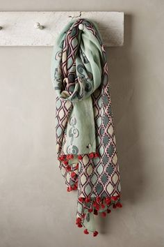 Pale greens juxtaposed with red are divine. The embroidery and pom pom details make this scarf a real wardrobe winner. From ANTHROPOLOGIE. Clothes For Sale, Clothes For Women, Woven Scarves, Handmade Scarves, Date Night Dresses, Scarf Design, Scarf Styles, A Boutique, Beauty Products