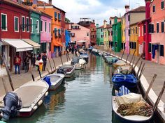 """Burano, Italy If you're ever in need of a mood booster, this cheery Technicolor town that's actually a tiny island in the Venetian lagoon, should do the trick. Its bright colors pop out in a way that gives it a tropical feel, with all of the houses here following a particular color pattern that dates back to the island's """"golden age"""" when it was first created."""