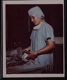 Captain Gladys R. Sepulveda, Operating Room Nurse, 8th Field Hospital, sorts surgical instruments before sterilizing.