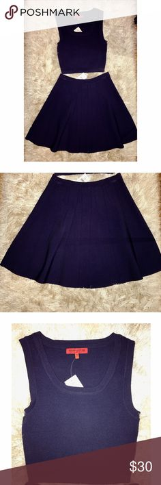 Wow Couture Skirt & Crop Top Set Wow Couture Skirt & Crop Top Set. Sleeveless top in size medium. Flare skirt in size large. Navy Blue. NEVER WORN WITH TAGS. WOW couture Skirts Skirt Sets