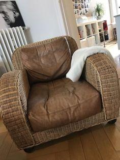Berühmter Sessel von Lambert, das Modell David Niven.Eine Armlehen weist größere Löcher im Rattangeflecht auf, siehe Fotos. Ansonsten altersgemäße Gebrauchsspuren.