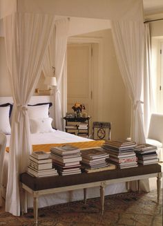 All white canopy bed in Givenchy's master bedroom.