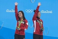 Canada's Meaghan Benfeito (left) and Roseline Filion celebrate on the podium after their bronze medal win in women's synchronized 10-meter platform diving at the 2016 Summer Olympics in Rio de Janeiro, Brazil, Tuesday, Aug. 9, 2016 THE CANADIAN PRESS/Frank Gunn