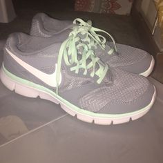 Nike Athletic Tennis Shoes Size:9 Grey and sea foam green Nike tennis shoes. Very comfy! Size women's 9. Only worn twice, I have too many Nikes! Please no trades or lowballers Nike Shoes Athletic Shoes