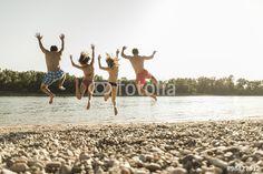 """Laden Sie das lizenzfreie Foto """"Friends jumping into river"""" von Westend61 zum günstigen Preis auf Fotolia.com herunter. Stöbern Sie in unserer Bilddatenbank und finden Sie schnell das perfekte Stockfoto für Ihr Marketing-Projekt!"""