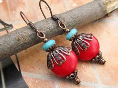 Boho Chic red earrings add a southwest flare to your outfit.  Red combined with turquoise blue is a striking color combo. Earrings are designed