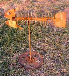 THIS IS A NEWER FISH SCULPTURE. MADE FROM DISCARDED GARDEN TOOLS LIKE ...