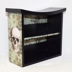 Add a touch of dark decor to your living space with this cabinet. Ive painted the cabinet black and added a decorative paper to the sides. The