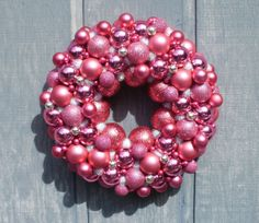 Z and I used pink and navy ornaments we got at Walmart's After Christmas sale, strung them on a wire hanger and made a cute wreath for her door.  We wrapped garland around it for an even more giddy-gaudy look!