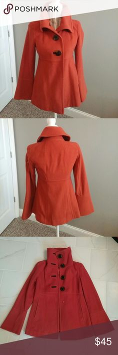 Jessica Simpson Coat Cute, cute coat by Jessica Simpson...a lovely shade of orange/auburn...worn several times, is in great condition.  Coat is a wool blend (80% wool)... has four large, brown/tortoise buttons and one snap for closure...fully lined...two pockets...button detailing in sleeve...hits at waist...size xs. Jessica Simpson Jackets & Coats