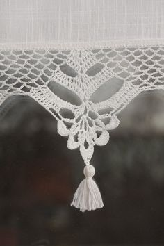 This short curtain is unique window decoration. The curtain is made from cotton fabric decorated with beautiful handmade crochet lace and handmade little tassels. The crochet lace is 12cm (4,5) high (18cm/7in with tassels). All my products are made of excellent quality yarn (100% cotton