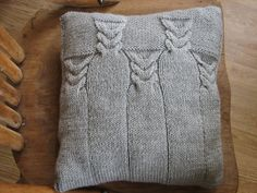 Ravelry: Pillar Cable Cushion pattern by Caroline Birkett