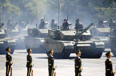 Soldiers of China's People's Liberation Army (PLA) stand in armoured vehicles during the military parade to mark the 70th anniversary of the end of World War Two, in Beijing, China, 3 September 2015