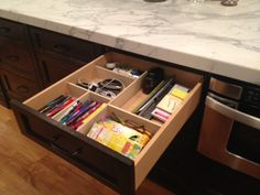 """I made these drawer dividers and finally tamed my kitchen junk drawer!  Used 3"""" craft poplar wood strips and Gorilla glue.  Instructions on http://biddlebits.blogspot.com/2012/08/easy-diy-kitchen-drawer-dividers.html"""