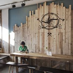 Stencil branding on recycled timber wall.