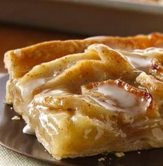 Treat your guests with this apple slab pie made using Pillsbury® pie crusts - a flavorful dessert.