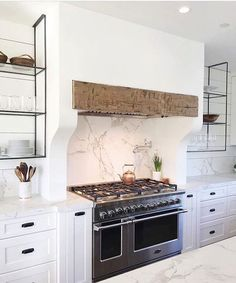 Luxury Small Kitchen Plaster hood with rough hewn beam insert. The Range Hood GuideBECKI OWENS - From dramatic statement hoods or those with a simple minimalist design, today I am sharing inspirations for range hood designs you might consider. Kitchen Hoods, New Kitchen, Kitchen Ranges, Kitchen Ideas, Kitchen Stove, Kitchen Designs, Kitchen Mantle, Kitchen Hood Design, Kitchen Chimney