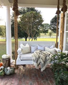 Swinging our Monday blues away on @cindimc.ivoryhome's perfect fall front porch! {Link in profile to shop} #designtheoutdoors #fallporch #autumnoutdoors