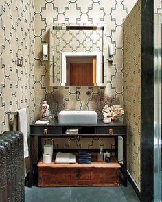 re-purpose an old desk into a sink pedestle in a small bathroom