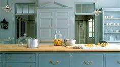 Pale blue colonial kitchen with brass hardware - Katy Elliott