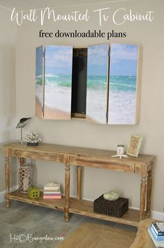 Free plans for a DIY wall mounted tv cabinet. Build a cabinet to hide the flat screen TV behind art in your home. Simple instructions for hidden tv cabinet you can make in a day on H2OBungalow