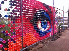 Australian street art duo Hyde & Seek create amazing public art using materials like colored plastic cups, plastic toy soldiers and even toast for that mat Art Environnemental, Art Public, Fence Art, Cup Art, East Street, Environmental Art, Street Art Graffiti, Recycled Art, Chalk Art