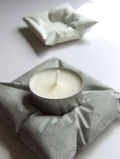 Looks like a cool DIY,cement tea light holders