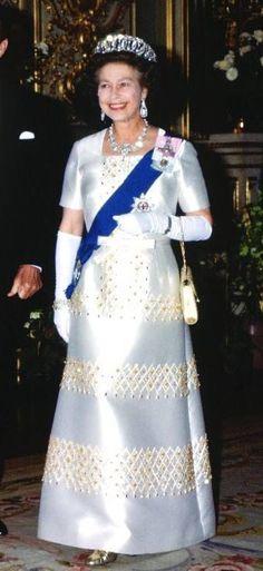 1982. Queen Elizabeth II wore a blue satin gown at Windsor Castle.