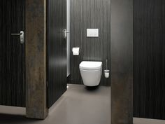 Toto public restroom design with touch-free and tamper-proof system./High-technology and ecology wall mount toilet/Photo credit: Toto