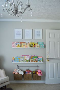 Nursery Reading Wall- hanging baskets, books, and art.