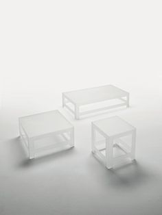 NEZU Design: Jasper Morrison | Collection of low tables in a new special double-faced extralight acid-etched glass, characterized by clean formality, delicate proportions and attention to detail. The legs and the top are shaped, chamfered 45°, tempered and thermo-welded together. A remarkable loading capacity is achieved through the particular structure of the table and the tempering process, despite the slenderness of the glass.