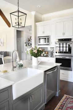 Farmhouse Kitchen. Farmhouse sink and faucet. Grey island with Farmhouse sink and faucet. #Farmhousesink #kitchenfaucet Beautiful Homes of Instagram @ourvintagenest