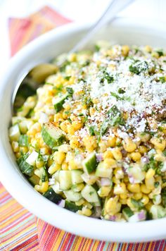 This slightly spicy corn and cucumber salad is inspired by Mexican street corn - topped with fresh cilantro and grated Cojita cheese.