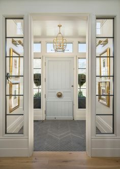 herringbone patterns: Foyer Flooring. Foyer with slate floor tile set in...