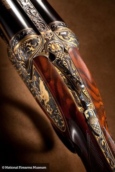 A stunning J. Purdey & Sons double rifle in Nitro Express. Engraved by Philippe Grifnee with a gold Rhino, Elephants and a stand of Cape Buffalos. The gold background inlay gives the gun a unique appearance and is tastefully set off by the deep relie Nitro Express, Gun Art, Custom Guns, Fire Powers, Gold Background, Hunting Rifles, Firearms, Shotguns, Revolvers