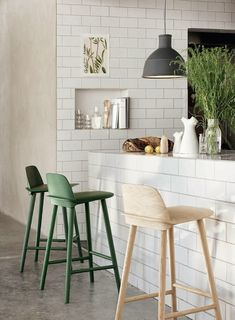 High stools by the breakfast bar - subway tiles - kitchen diner